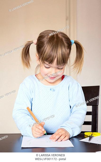 Portrait of little girl with green crayon