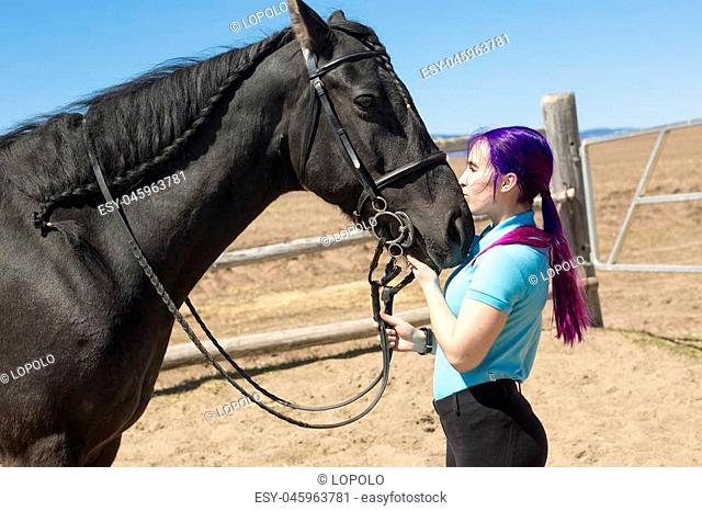 A Beautiful teen girl on the farm with her horse