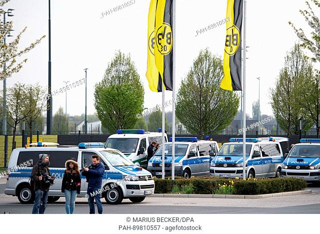 Police cars park outside the training grounds of Borussia Dortmund in Dortmund, Germany, 12 April 2017. Three explosions occurred near the road blockade next to...