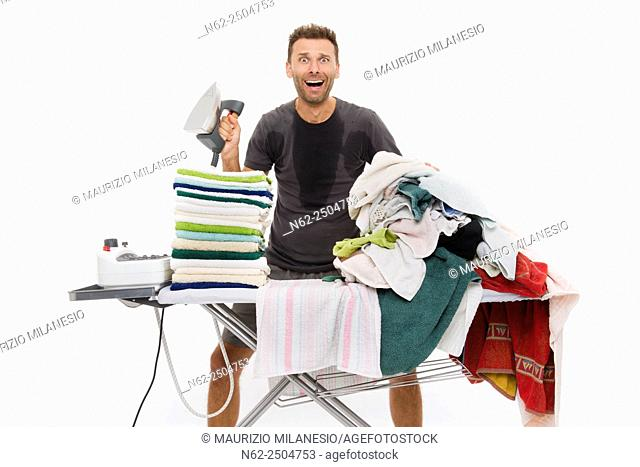 Very sweaty man, Goes berserk behind an ironing board full of clothing