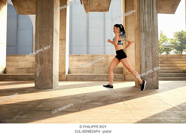 Woman jogging in urban area