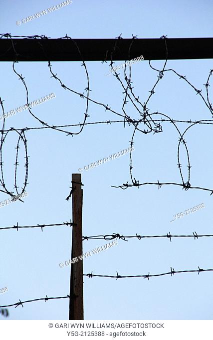 barbed wire fence and blue sky
