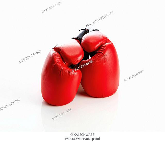 Red boxing gloves against white background