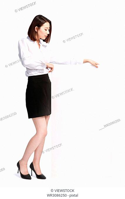 Business young woman holding a white board