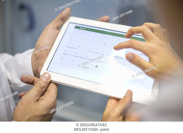 Two scientists sharing tablet