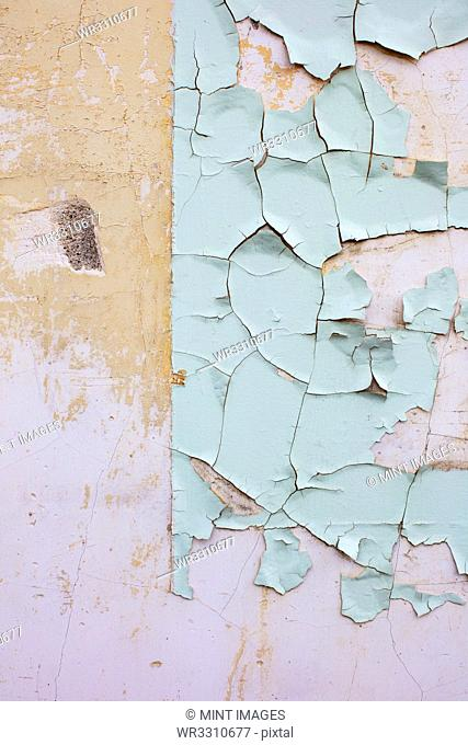 Close up of peeling paint on wall