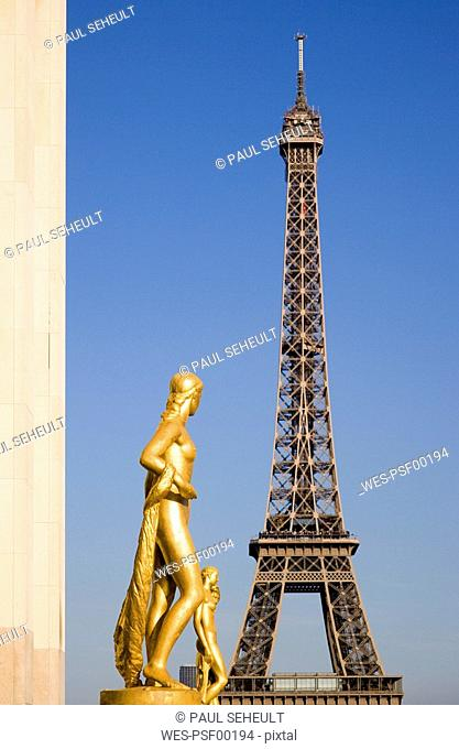France, Paris, Eiffel Tower, Statues in foreground