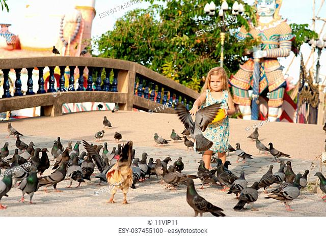 Girl and birds in Thailand
