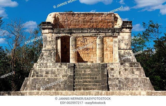 Building of Mayan origin, thought to be a ceremonial throne room, rises out of the jungle at Chichen
