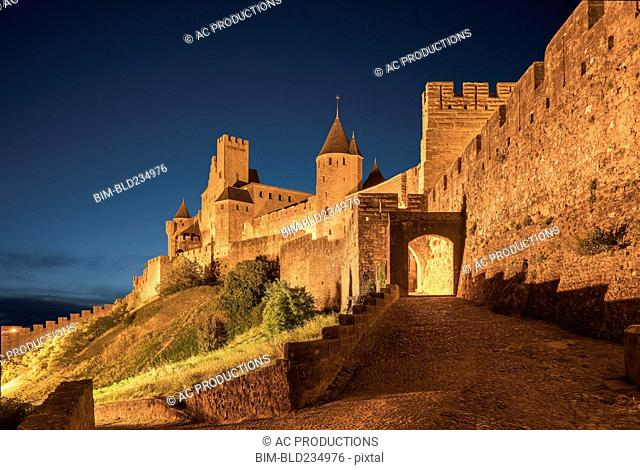 Road to castle at night in Carcassonne, Languedoc-Roussillon, France