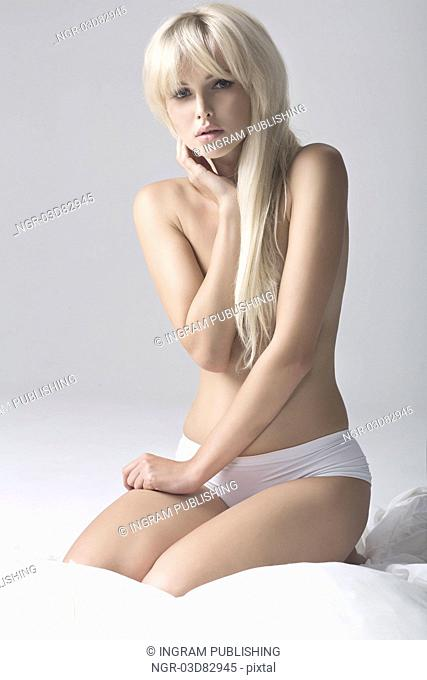 Portrait of Fresh and Beautiful blonde girl on bed