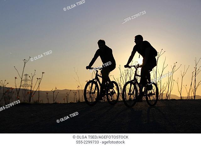 Two cyclists, Passeig de les Aigües; Collserola mountain, Barcelona, Catalonia, Spain