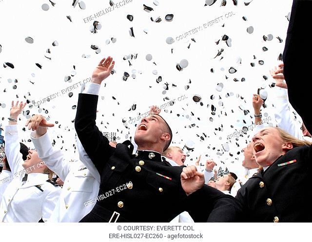 Newly commissioned Navy ensigns and Marine Corps 2nd Lieutenants toss their hats into the air at their 2006 graduation and commissioning ceremony