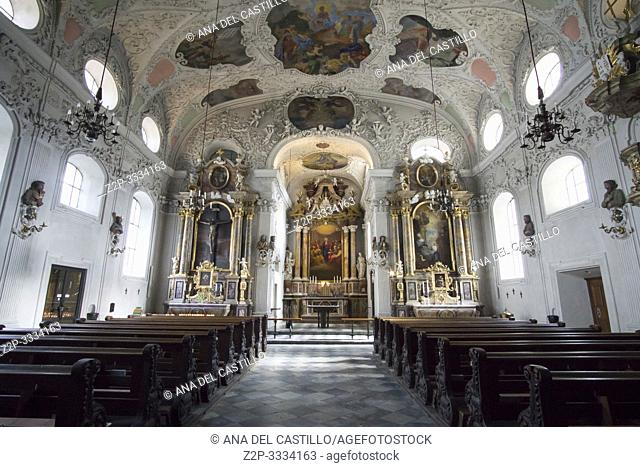 Innsbruck city center Austria on April 16, 2019: Maria-Theresien-Strasse Hospital Church of the Holy Spirit