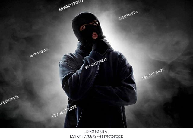 Masked thief thinking