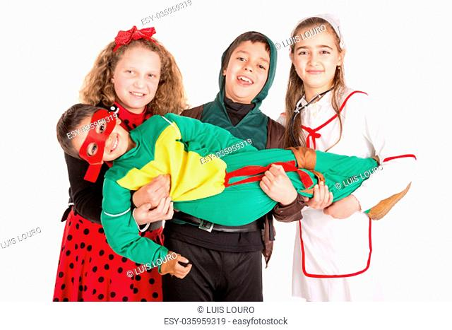 Group of kids in Halloween/Canaval costumes isolated