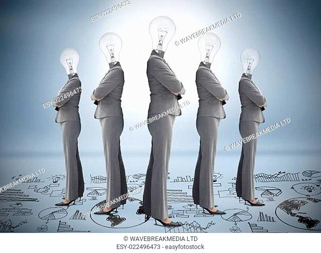 Businesswoman with bulb head multiplied standing on floor of graphs on blue background