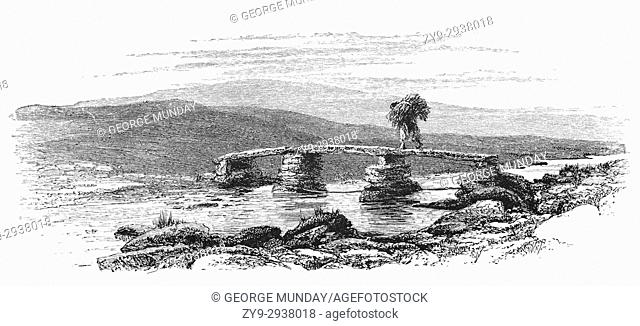1870: The Postbridge Clapper Bridge is an ancient water crossing the East Dart River and formed by large flat slabs of stone