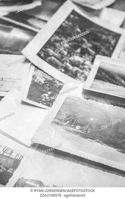 Nostalgic close up on old black and white photographs. Tracing back family history