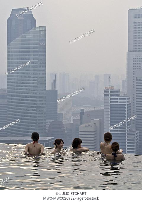 Guests relax at the Infinity Pool at the famous Marina Bay Sands Hotel SkyPark, Singapore
