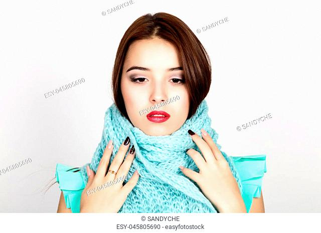 close-up portrait of a beautiful woman in a woolen scarf