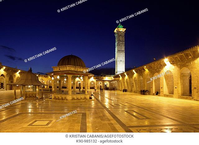 Empty courtyard of Great Omayyaden (Umayyad) Mosque in the late evening with light and dark blue sky, Aleppo, Syria, Middle East, Asia
