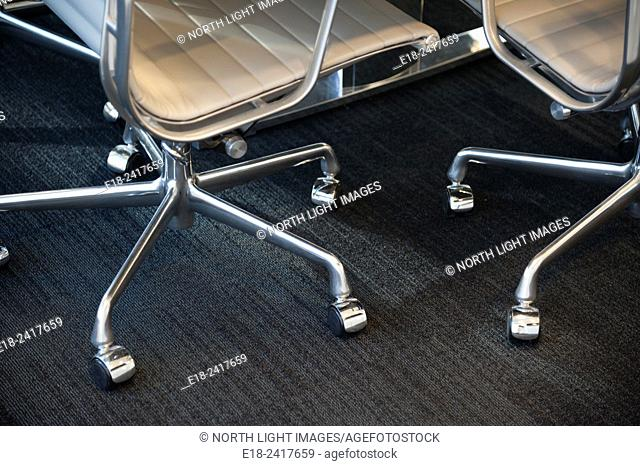 Canada, BC, Vancouver. Chrome and leather office chairs in corporate board room