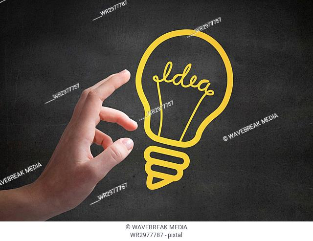 Hand pointing at 3D yellow lightbulb graphics against grey wall