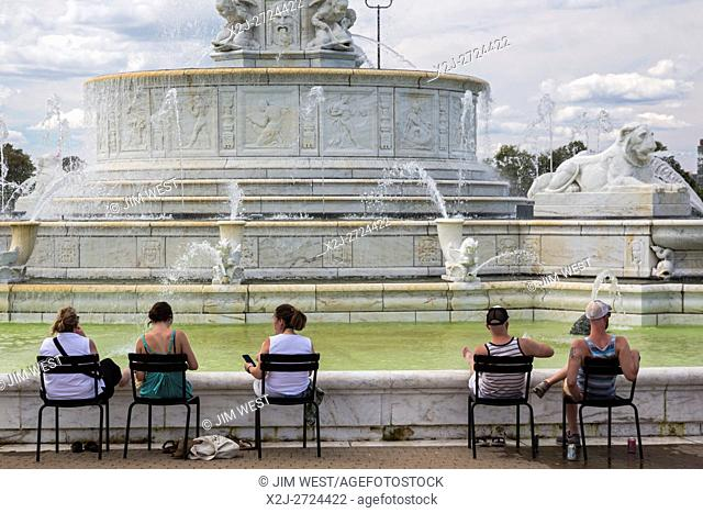 Detroit, Michigan - People relax around Scott Fountain on Belle Isle on a summer Sunday afternoon