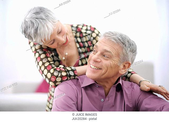 Portrait of happy senior couple at home