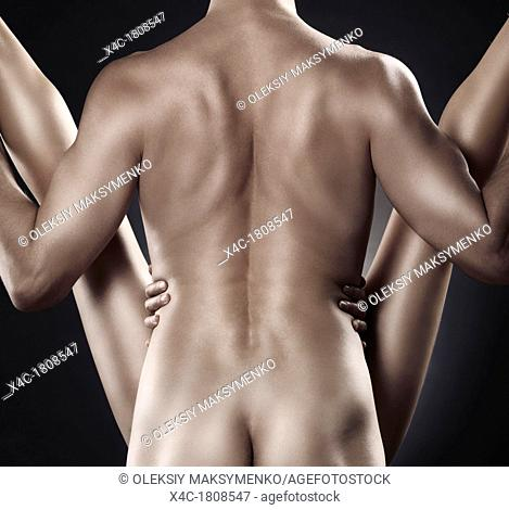 Couple making love  Artistic closeup of muscular man back and woman legs