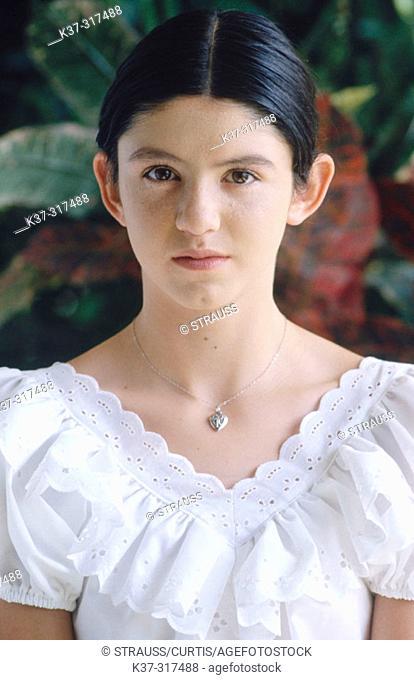 Young hispanic girl wearing white blouse