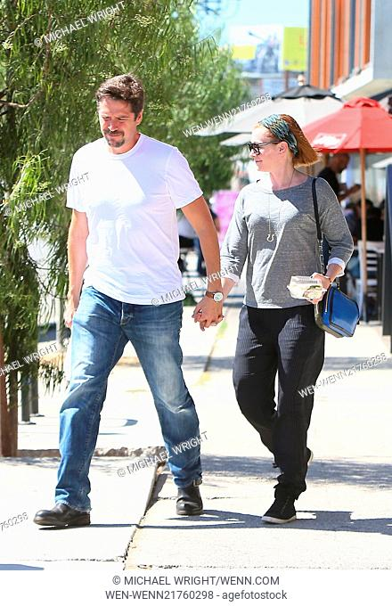 Alyson Hannigan and her husband Alexis Denisof spotted leaving Toast Bakery Cafe Featuring: Alyson Hannigan,Alexis Denisof Where: Los Angeles, California