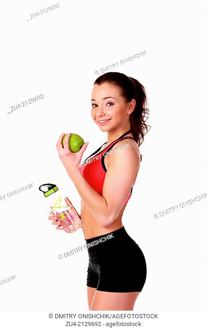 Young female model with apple anf flask