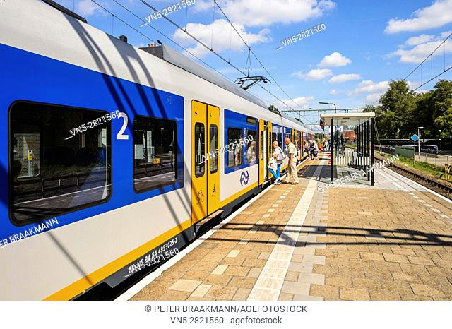 """OUDENBOSCH, THE NETHERLANDS â. """" September 1: Passenger train rides inside station to let passengers in and out on Setember 1, 2016"""