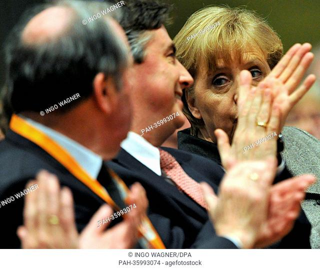 German Chancellor Angela Merkel (CDU) looks past the applauding hands of Premier of Lower Saxony David McAllister (CDU, C) during the New Year's reception of...