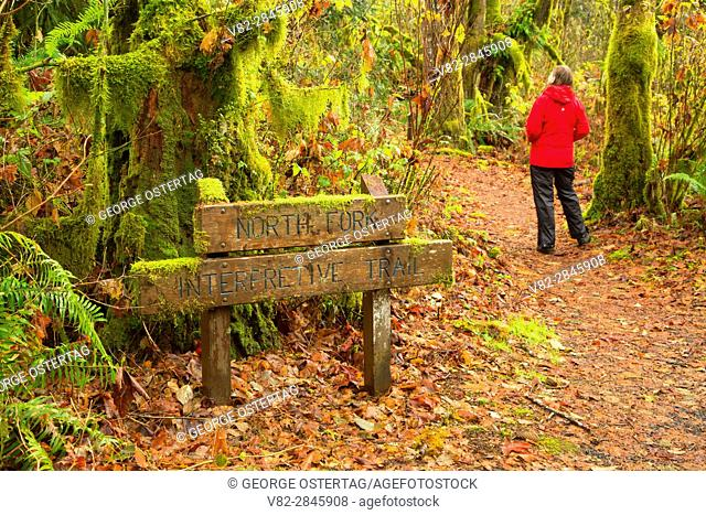 Hiker on North Fork Trail with trail sign, Clemens Park, Benton County, Oregon