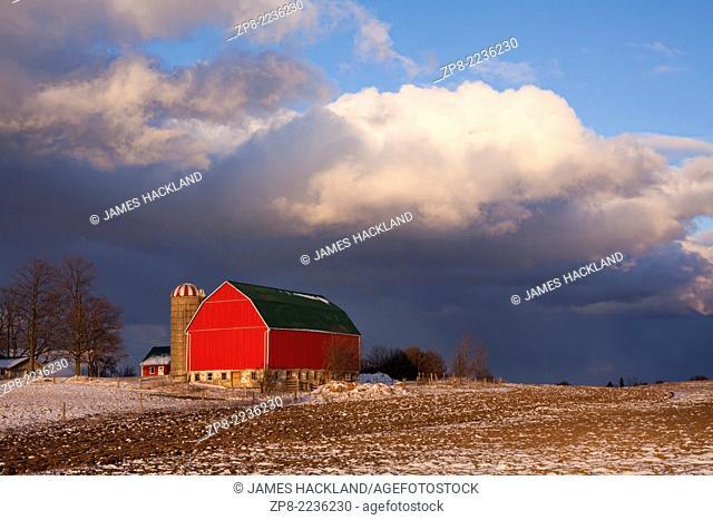 A red barn under stormy skies near Caledonia. Roblyn Farm, Haldimand County, Ontario, Canada