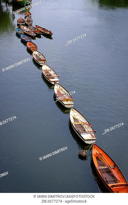 Moored rowing boats ,River Thames at Richmond Upon Thames,Greater London,England