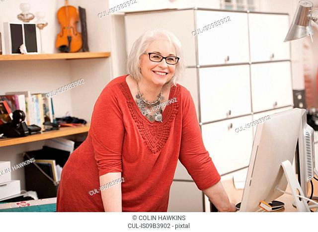 Woman smiling at work desk
