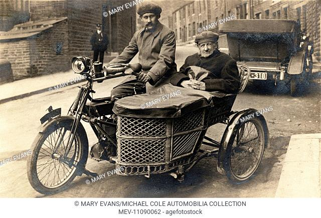 Two gentlemen on a 1907 Royal Enfield motorcycle & wicker sidecar in the street circa 1910