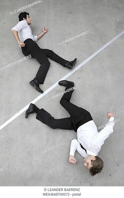 Two businessmen in a hurry, elevated view