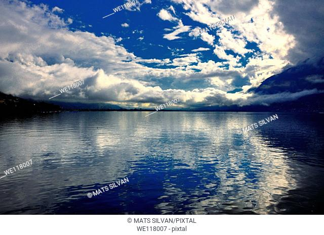 Blue sky with clouds over a lake
