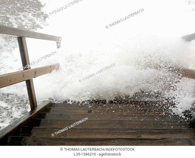 Stairs at the sea of roaring waves recorded, Sylt, Germany