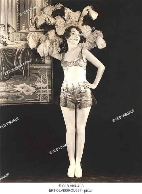 Showgirl wearing feathered headdress
