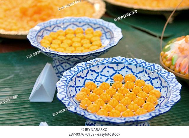 Traditional, Thai style, handmade candies, presented on a pretty plate for sampling by tourists at a village in Thailand