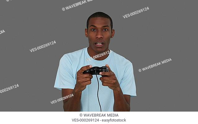 Casual young man playing video games