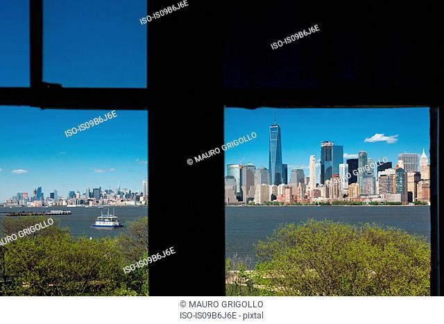 Silhouetted window frame view of Manhattan cityscape and skyline, Times Square, New York, USA
