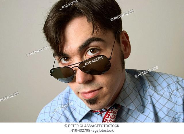 Man, in his mid-thirties, posed wearing sunglasses