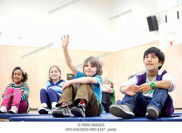 elementary student asking question in the gymnasium